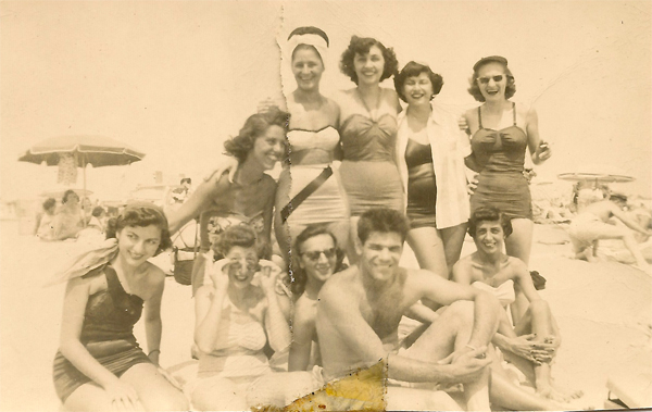 Having a grand time! Wish you were here! Nine women and one man at the beach. Unidentified. Collection of E. Ackermann.