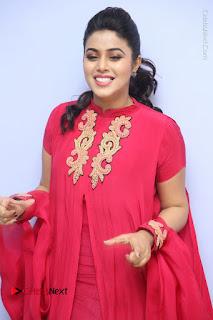 Actress Poorna Latest Stills in Red Dress at Rakshasi First Look Launch  0103.JPG