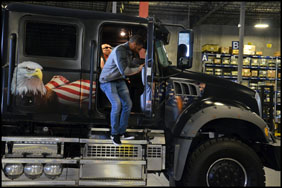 Darrell 'Bubba' Wallace checks out Jack Mack, an 800hp Mack Granite Crew Cab