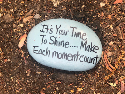 """Rock with painted message: """"It's Your Time to Shite...Make Each moment count"""""""