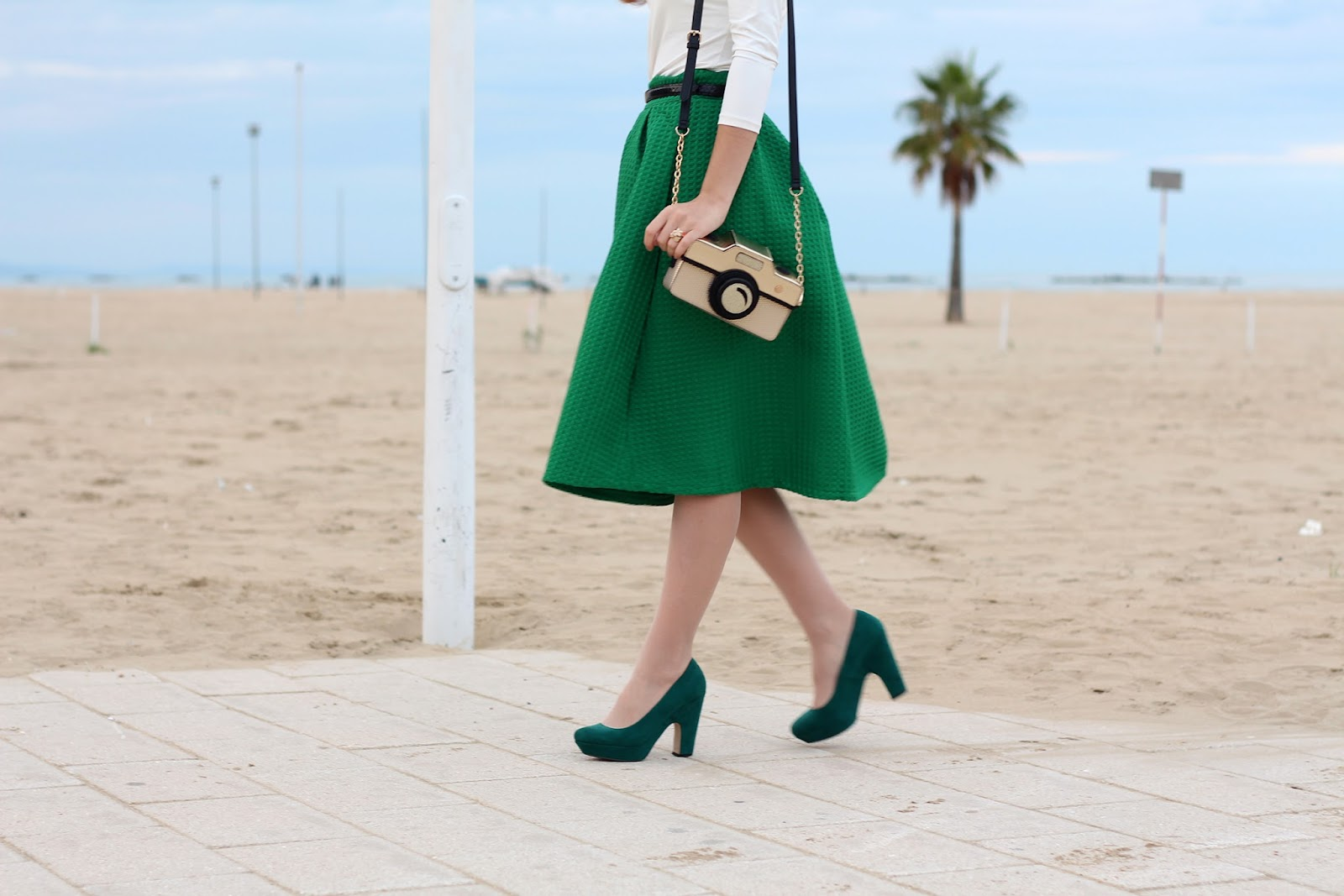 green midi skirt accessorize camera bag heels pumps shoes