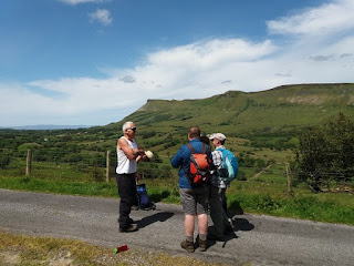 Walkers chatting on road in Glenade Leitrim with views of the Dartry mountains in the background