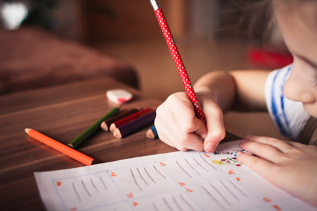 child writing and learning