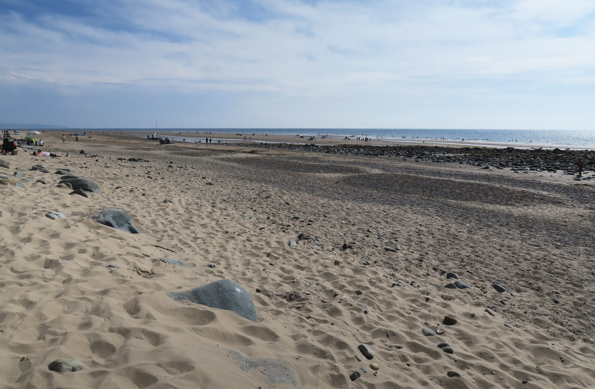 Looking across the beach at Shell Island. The foreground is sandy but the shore is shingle