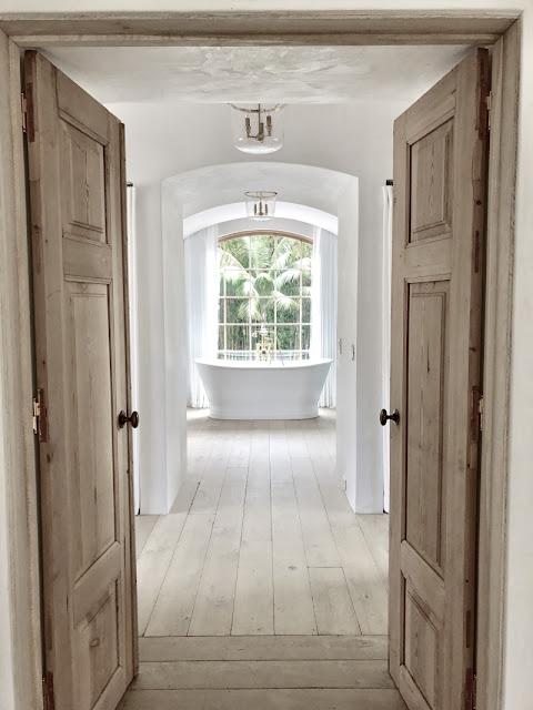 Modern farmhouse renovation in malibu steve brooke for Master bathroom door
