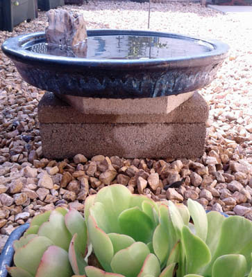 Photo of a stone in a bird bath