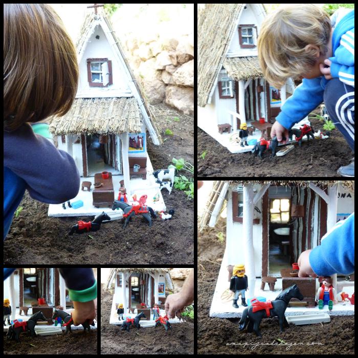 niños jugando a ser labradores con la barraca
