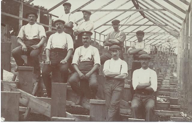 Men inside half built stands