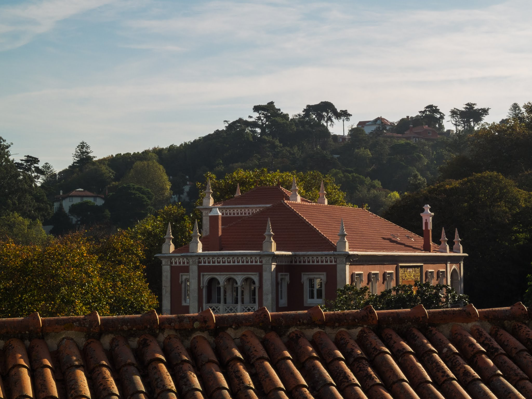 View of a building over a terracotta rooftop in Sintra, Portugal.