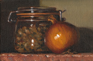Still life oil painting of a brown onion beside a preserving jar partially filled with pistachios.