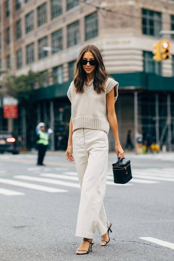 Fall Trend: Felicia Akerstrom in a sleeveless sweater, beige pants, and strappy heels