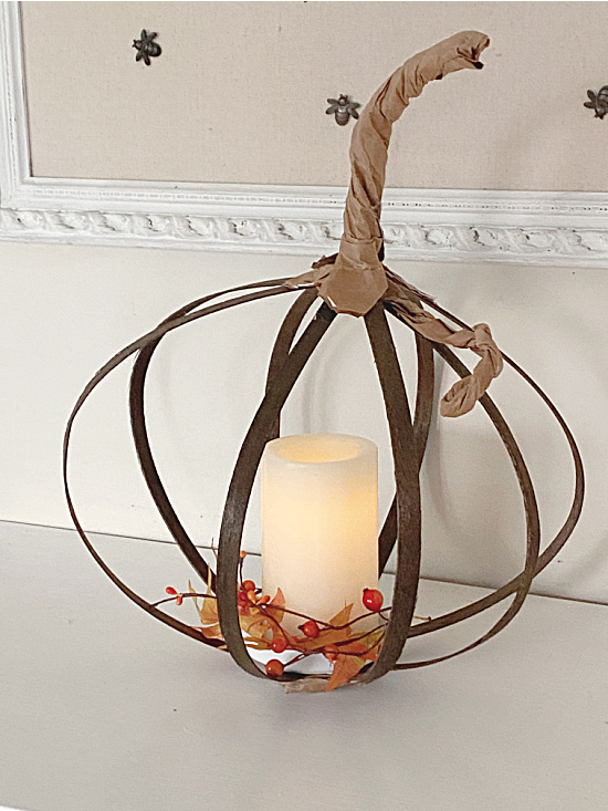 wooden slat pumpkin with candle
