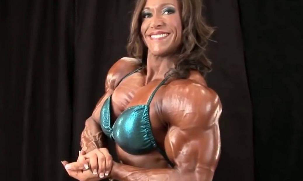 Video Girl bodybuilding muscle flexing big biceps