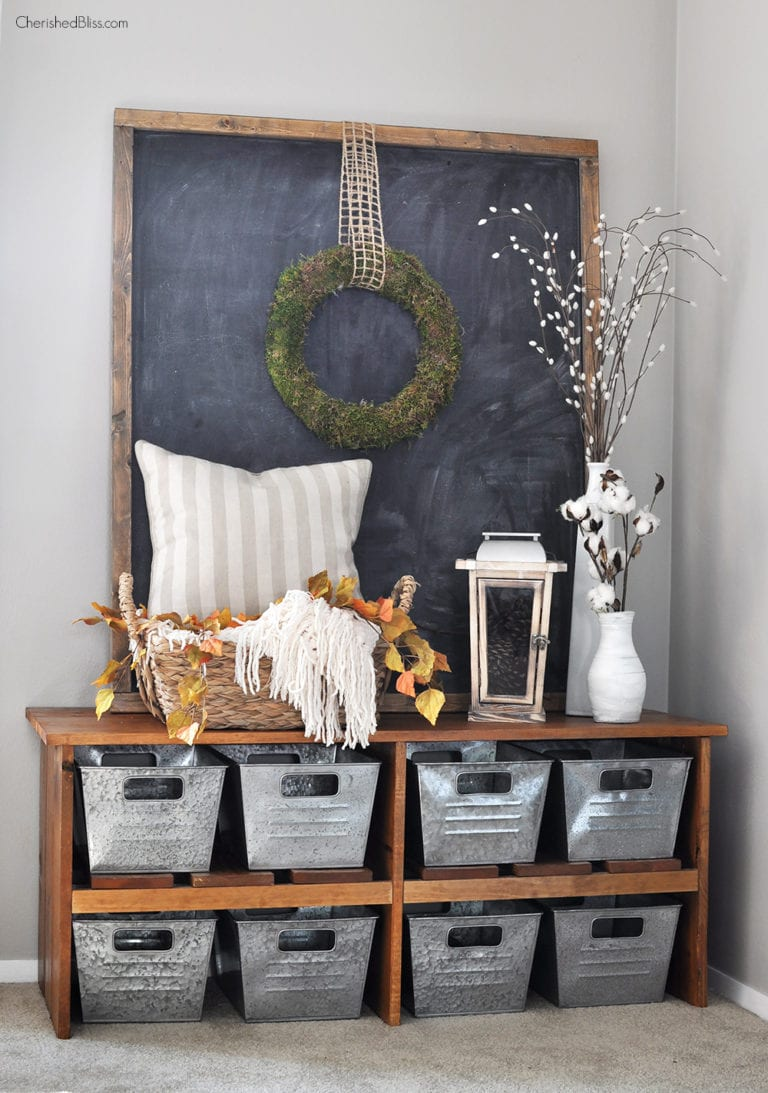 Beautiful rustic farmhouse style entryway bench decorated for fall.
