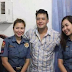 Two policewomen get bashed for posing with Fernandez right after arrest