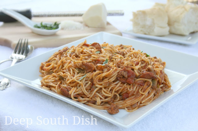A spaghetti meat sauce made with the trinity and thin slices of spicy, andouille sausage, for a taste of the Deep South.