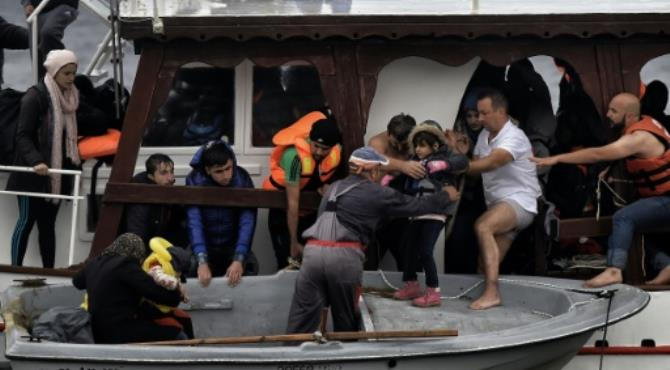 """Local residents of Lesbos help refugees and migrants to disembark from a small wooden ship arter arriving at Lesbos island from Turkey. By Aris Messinis (AFP/File) Oslo (AFP) - Syrian rescuers risking all to save war-hit civilians and the brokers of Iran's nuclear deal are among contenders for Friday's Nobel Peace Prize after Colombia's peacemakers fell from pole position.  As the annual Nobel prize-giving week reaches its peak, the five-member Norwegian committee will unveil its decision at 0900 GMT, the only one of six awards to be presented in Oslo and the one which traditionally garners the greatest attention.  For once, Experts, online betting sites and commentators had thought they were on to a sure thing with Colombian President Juan Manuel Santos and FARC chief Rodrigo London, alias Timoleon """"Timochenko"""" Jimenez, widely seen as frontrunners after signing a deal to end 52 years of civil war.  But they were suddenly forced to rethink after voters in Colombia rejected the agreement between their government and the communist FARC rebels in an October 2 referendum.  That threw the prestigious prize wide open again, and with a record 376 nominations to consider, predicting the winner is largely a lottery, with experts far from unanimous over who the committee will choose."""