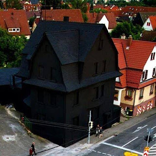 House painted entirely black