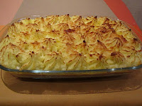 Pastel de patatas y carne gratinado