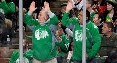 hockey fans pounding glass