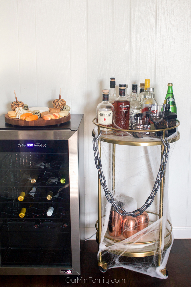 Halloween decorations bar cart and NewAir wine mini fridge