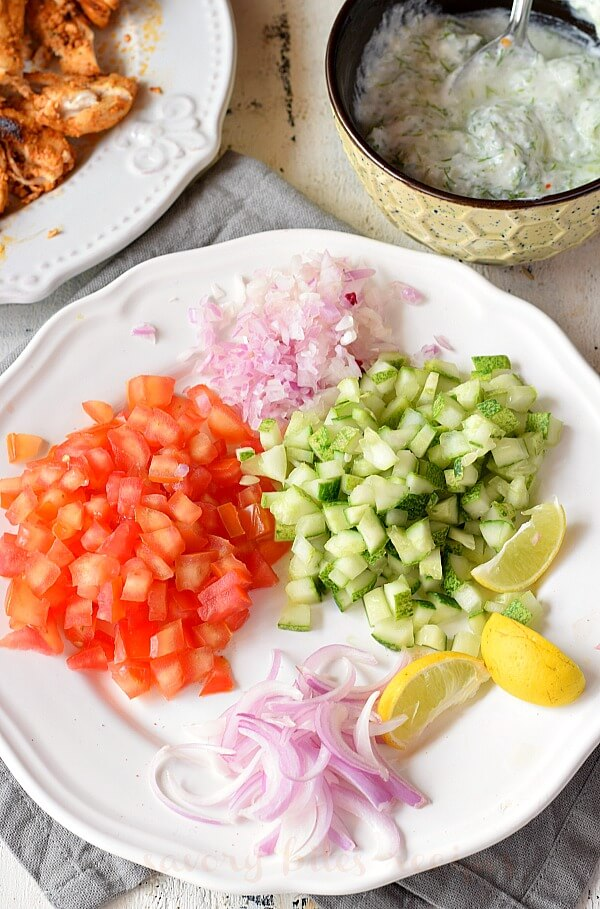 a white plate with chopped vegetables