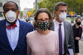 Clare Bronfman, center, arriving at Federal District Court in Brooklyn on Wednesday. Ms. Bronfman is the first defendant to be sentenced in the Nxivm investigation.Credit...John Minchillo/Associated Press