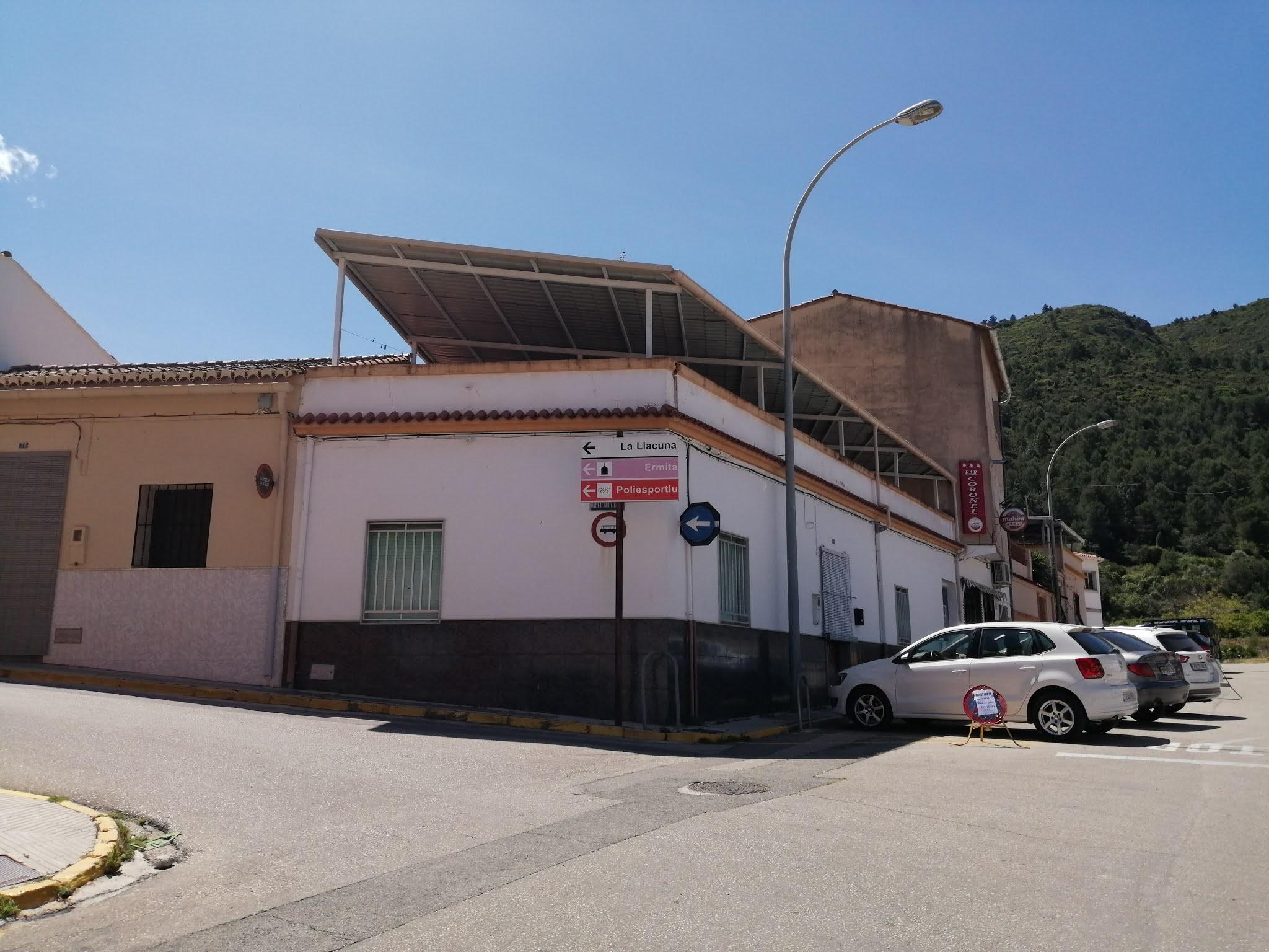 Signpost indicating la Llacuna in Villalonga, Valencia, Spain