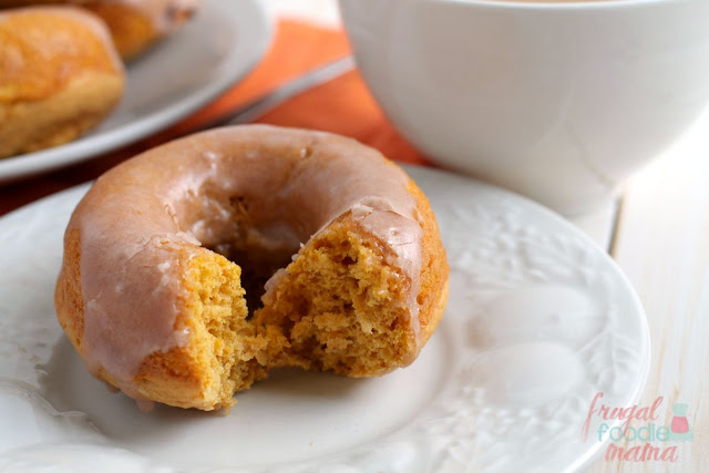 Moist cake donuts are packed with pumpkin and then drizzled in a cinnamon glaze in these delicious Cinnamon Glazed Pumpkin Buttermilk Donuts.