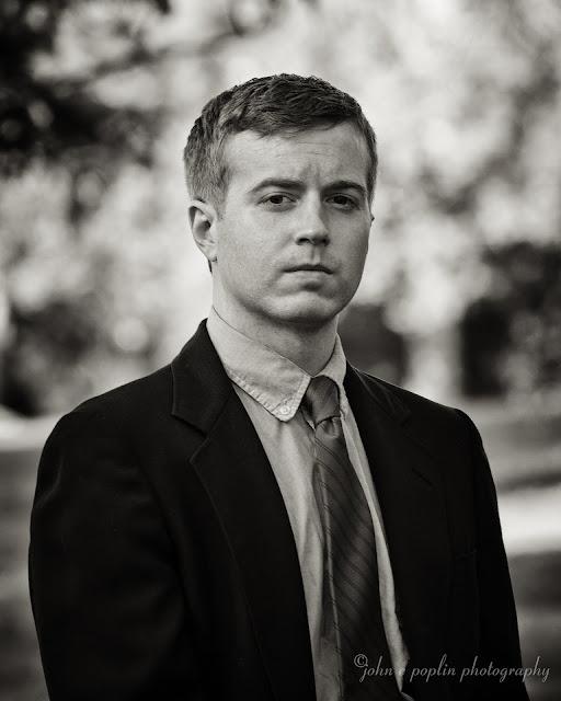 Black and white headshot portrait of a recent college graduate in Boulder Colorado