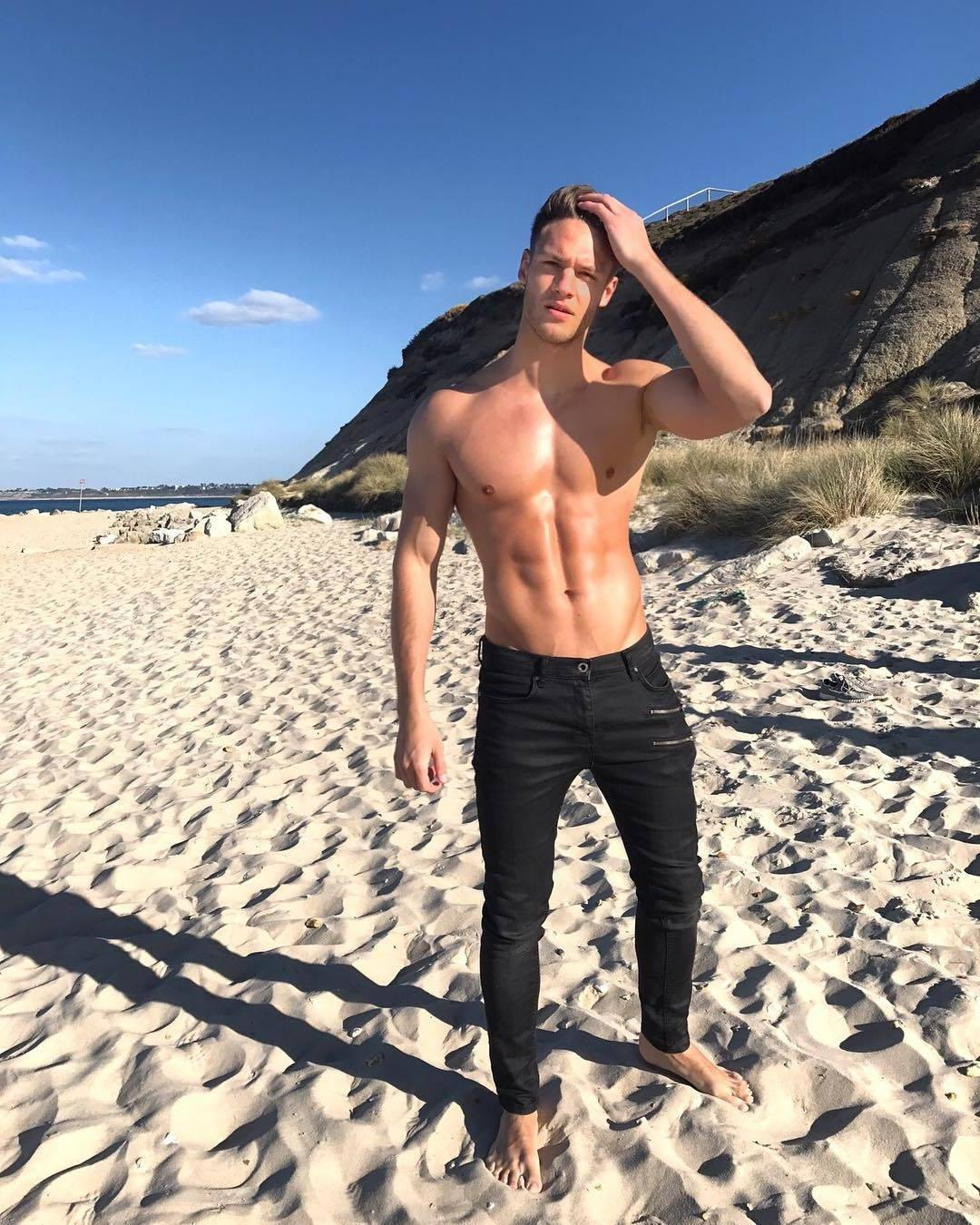 fit-shirtless-male-model-shiny-chest-sixpack-abs