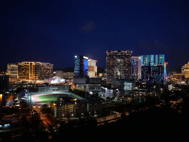 view of the Macau University of Science and the Morpheus hotel from the Grand Taipa Hiking trail at night