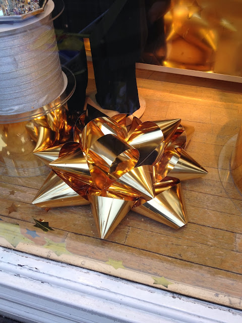 giant gold rosettes in shop window