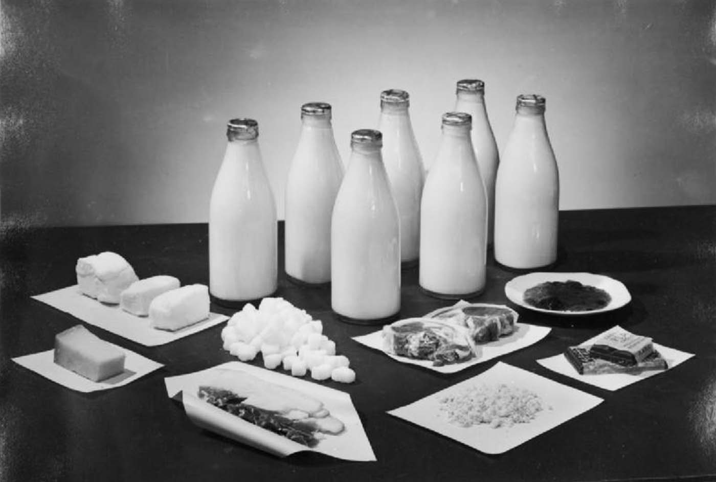 This photograph shows the amounts of of butter, milk, bacon, lard, sugar, cheese, tea and jam received by two people per week in Britain.