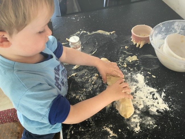Toddler-rolling-mixture-into-shape