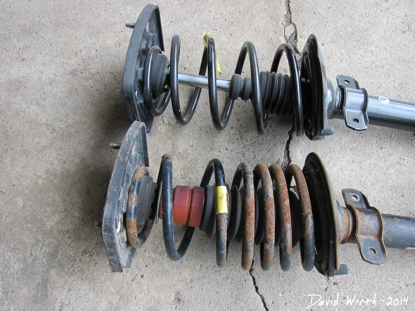 worn struts, car, monroe quick struts, rusted, warranty
