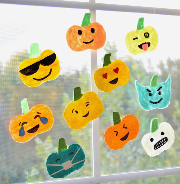 how to make emoji pumpkins window clings using hot glue and puffy paint