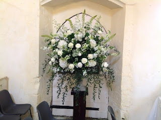 white wedding flowers in church, Suffolk