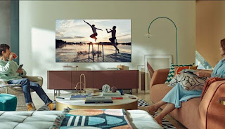 Woman and Boy watching Samsung Neo QLED TV