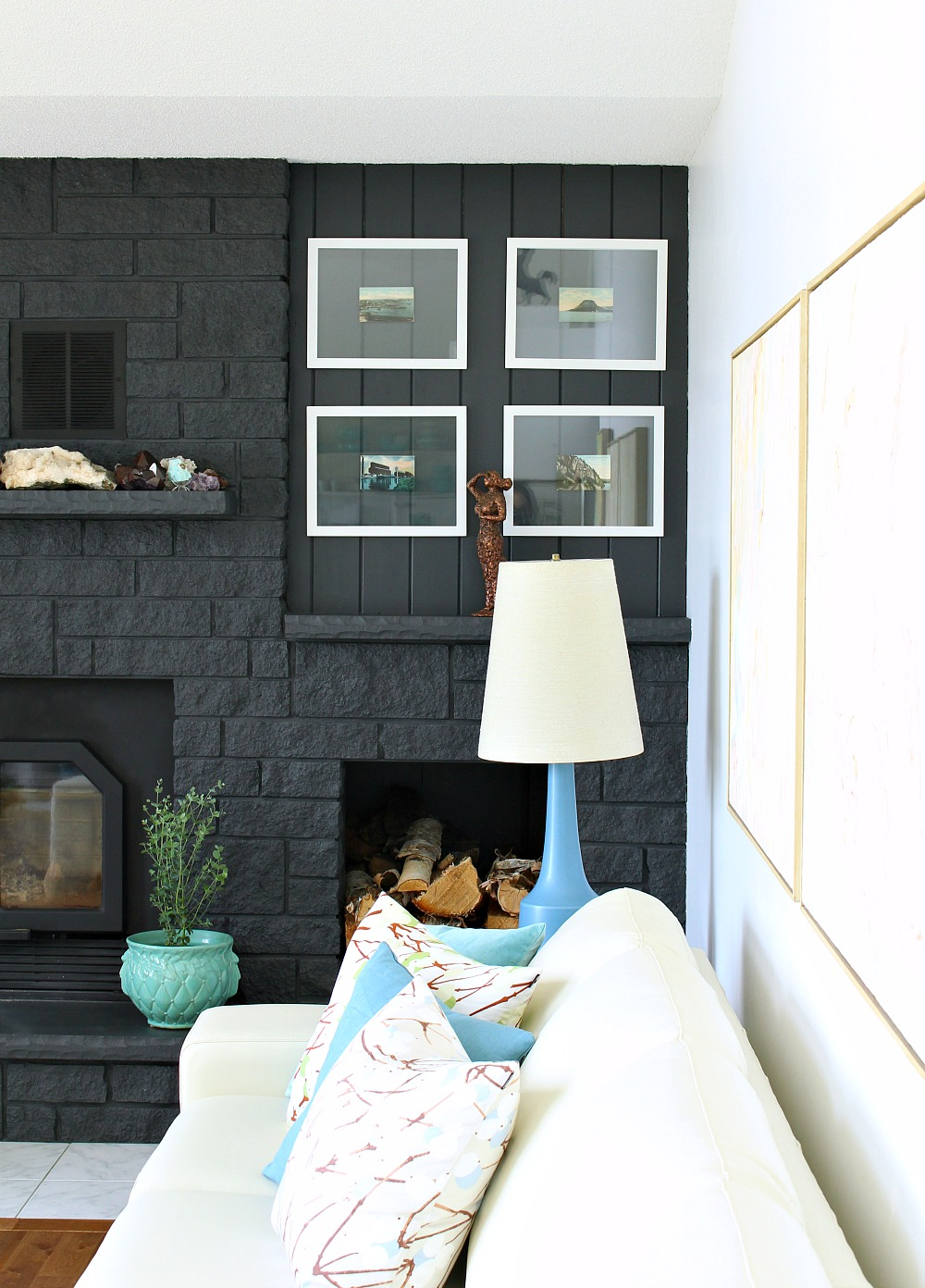 Fireplace Painted Dark Grey with Rock Collection on Display