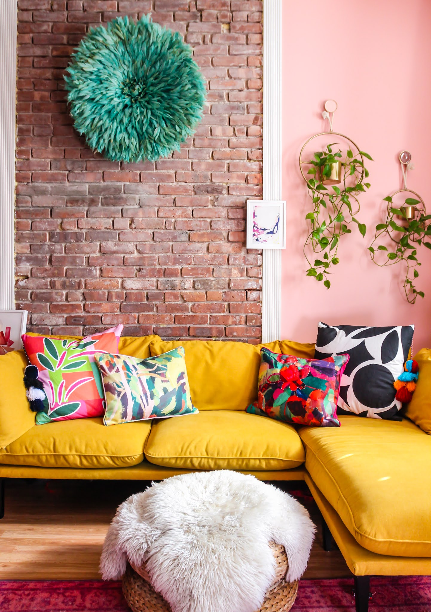 colorful throw pillows // missio throw pillow // Annie Selke throw pillows // opal house throw pillows // yellow sofa // bright throw pillows // exposed brick living room // pink living room // pink and yellow decor