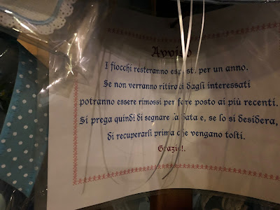 Fiocchi or birth announcements in the Santurio Regina Pacis in Boves, Italy.