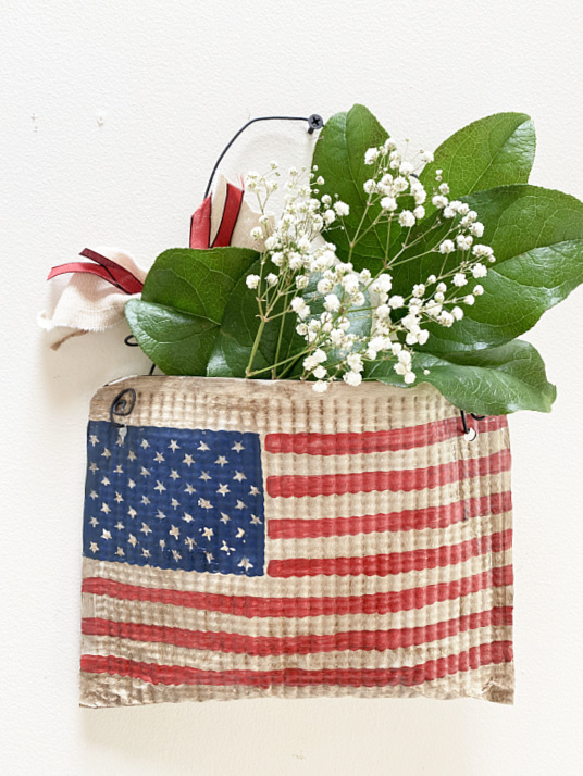 American flag pouch filled with leaves and baby's breath