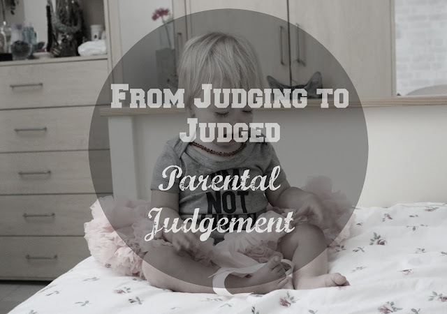 crying baby sat on bed wearing I'm not tired vest - header image with text over from judging to judged - parental judgement