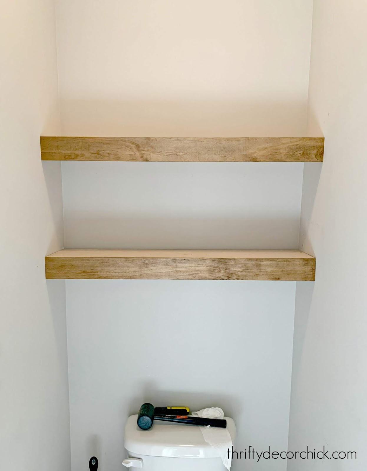 Installing shelves above toilet