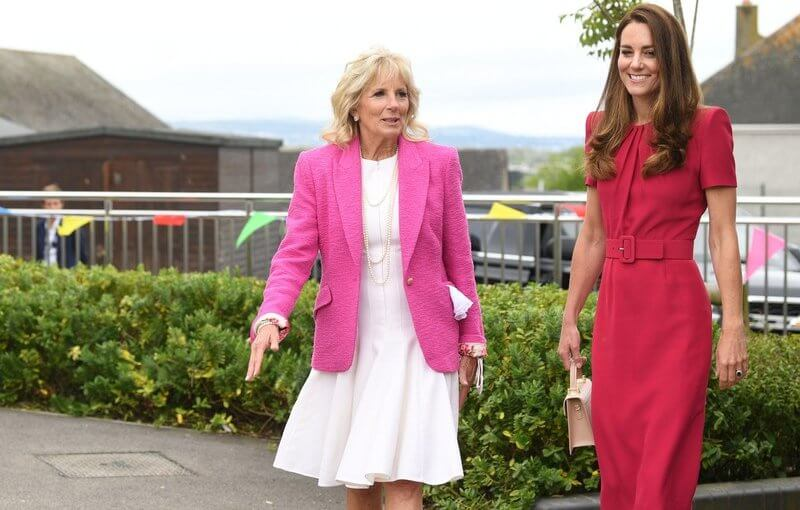 Kate Middleton wore a new midi pencil dress from Alexander McQueen. US First Lady Jill Biden wore a pink tweed blazer from L'agence