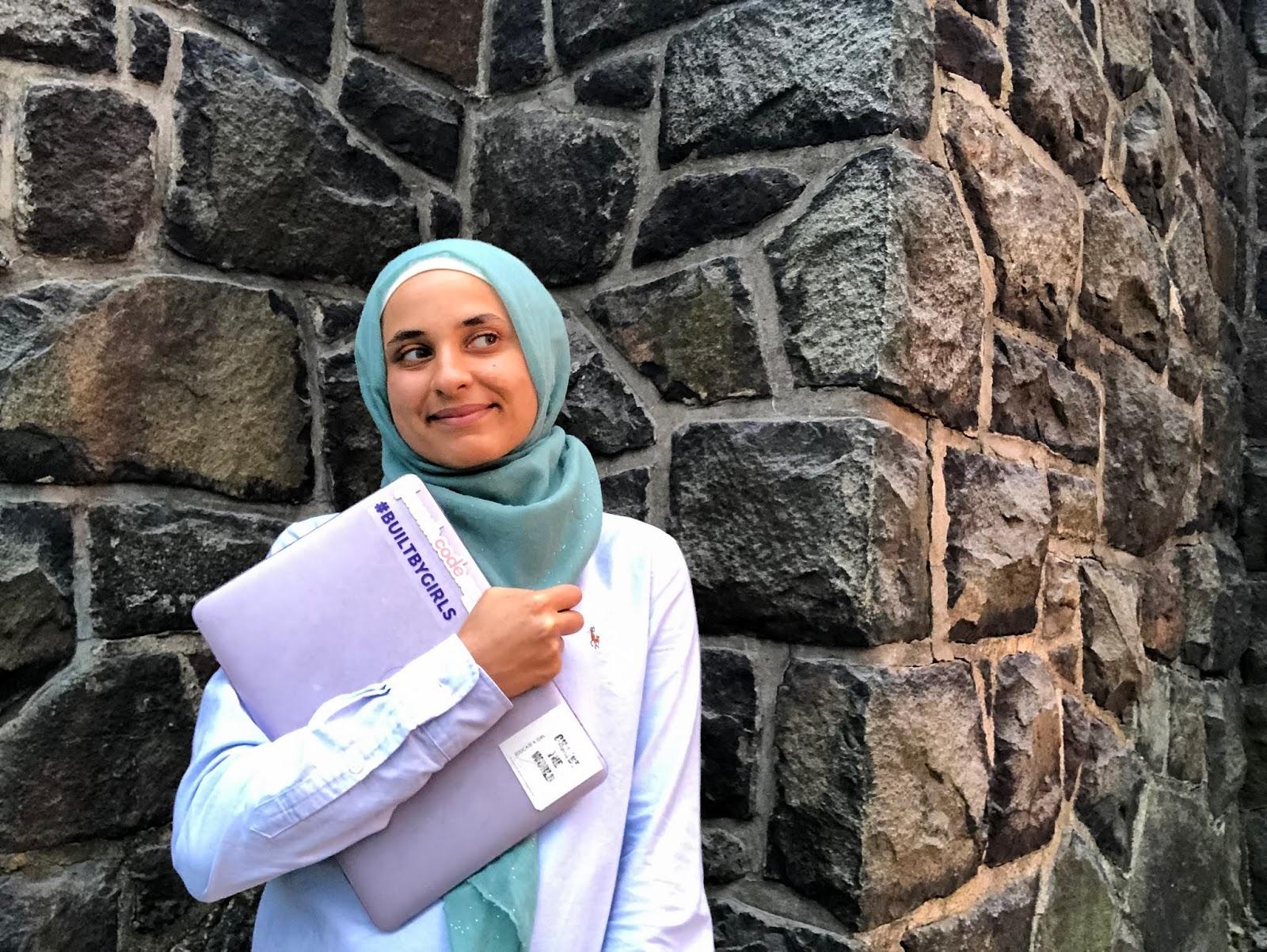 sahara holding laptop