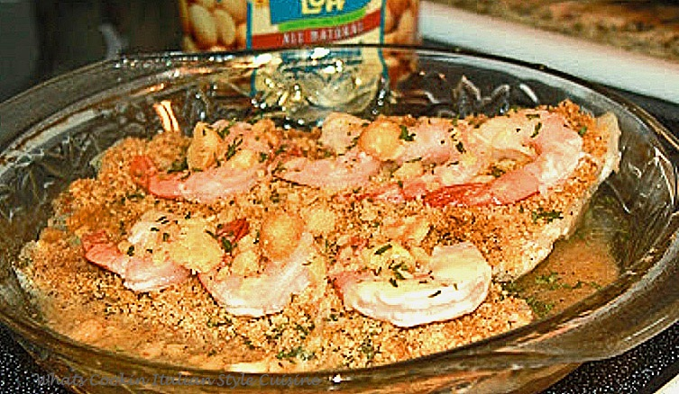 flounder crusted with macadamia nuts with a shrimp stuffing in butter sauce