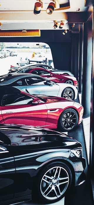 Sport cars parked Inside showroom wallpaper