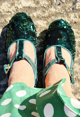 Close-up of green sequin T bar shoes from Irregular Choice
